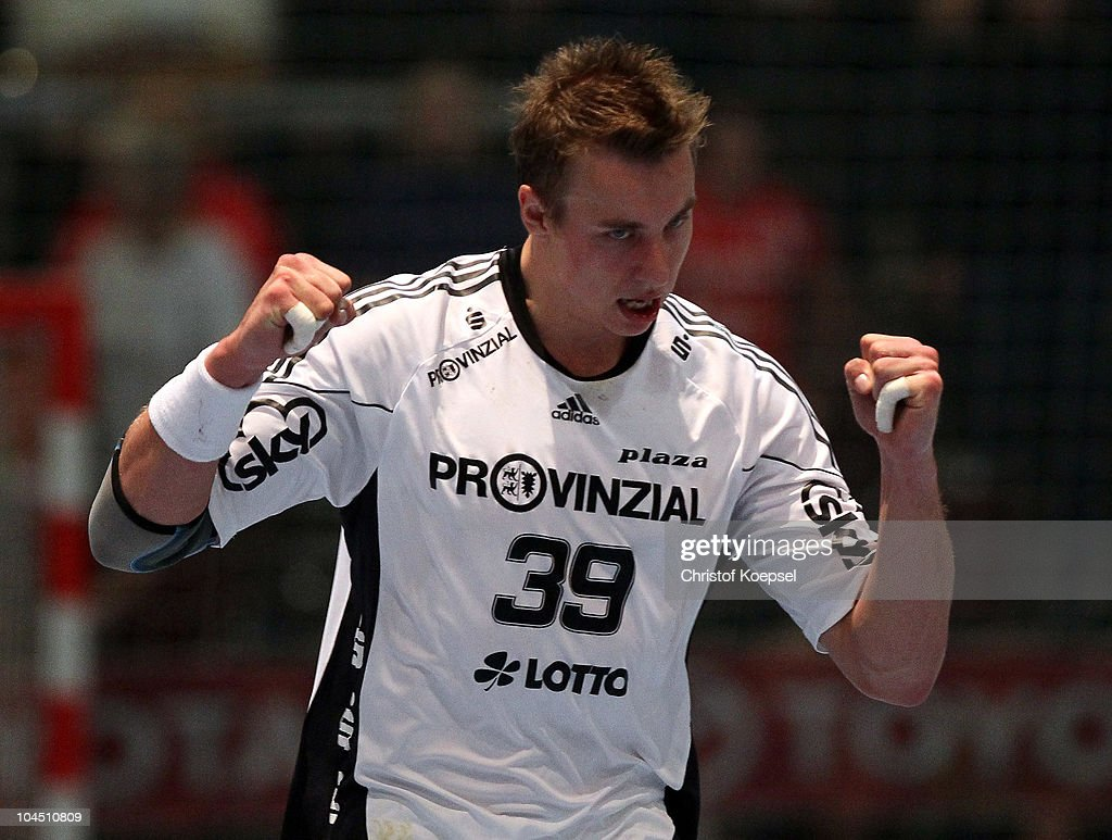 <a gi-track='captionPersonalityLinkClicked' href=/galleries/search?phrase=Filip+Jicha&family=editorial&specificpeople=620584 ng-click='$event.stopPropagation()'>Filip Jicha</a> of Kiel celebrates a goal during the Toyota Handball Bundesliga match between MT Melsungen and THW Kiel at the Rotehnbach Hall on September 28, 2010 in Kassel, Germany.