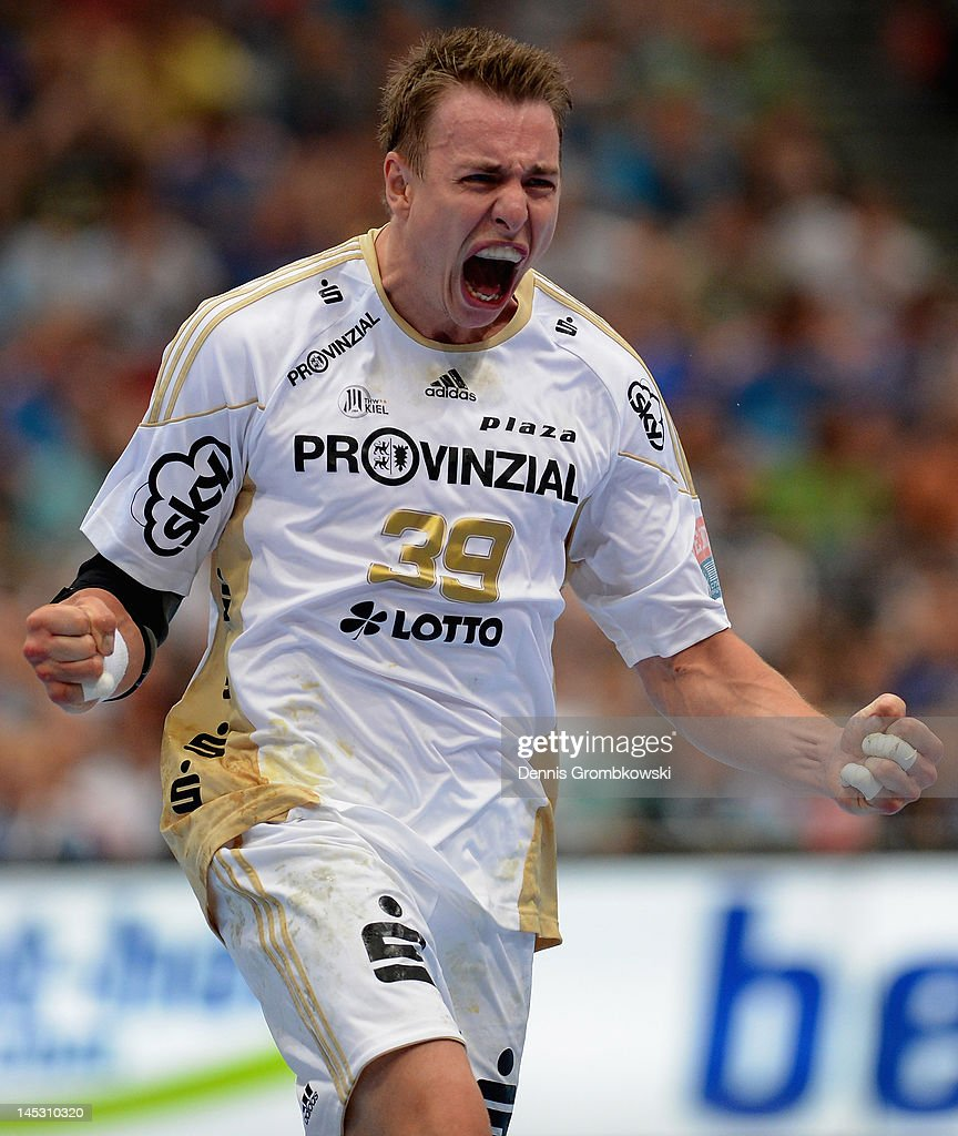 <a gi-track='captionPersonalityLinkClicked' href=/galleries/search?phrase=Filip+Jicha&family=editorial&specificpeople=620584 ng-click='$event.stopPropagation()'>Filip Jicha</a> of Kiel celebrates after scoring during the EHF Final Four semi final match between Fuechse Berlin and THW Kiel at Lanxess Arena on May 26, 2012 in Cologne, Germany.