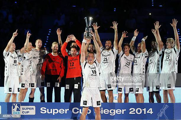 Filip Jicha of Kiel celebrates with his teammates after winning the DKB HBL Supercup match between THW Kiel and Fuechse Berlin at Porsche Arena on...