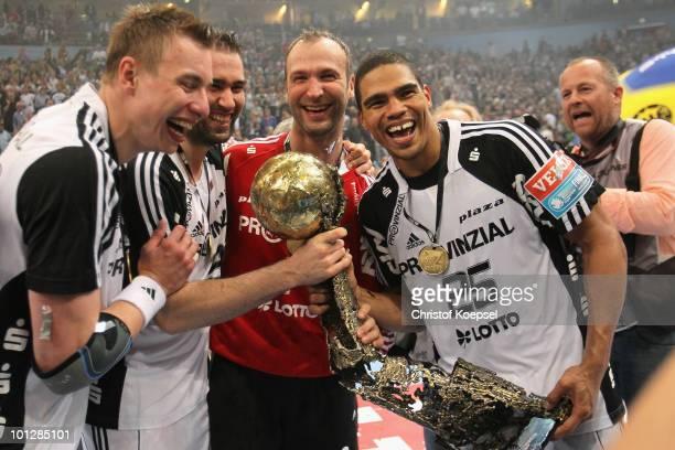 Filip Jicha of Kiel Ihor Anic Thierry Omeyer and Daniel Narcisse present the handball champions league trophy after winning 3634 the handball final...