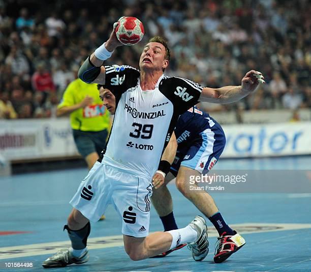 Filip Jicha of Kiel is challenged by Vladimir Temelkov of Balingen during the Toyota Handball bundesliga match between THW Kiel and HBW...