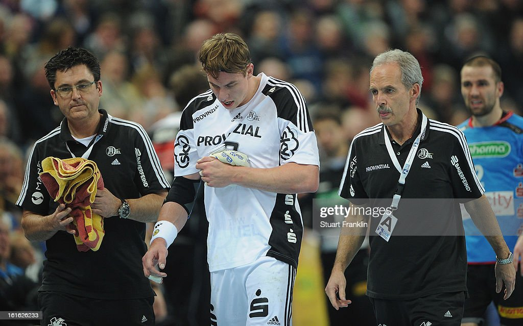 <a gi-track='captionPersonalityLinkClicked' href=/galleries/search?phrase=Filip+Jicha&family=editorial&specificpeople=620584 ng-click='$event.stopPropagation()'>Filip Jicha</a> of Kiel is taken off injured during the HBL Bundesliga game between THW Kiel and TSV Hannover-Burgdorf at the Sparkassen arena on February 13, 2013 in Kiel, Germany.