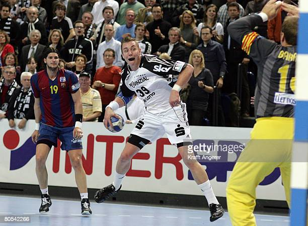 Filip Jicha of Kiel jumps to shoot during the EHF Champions League semi final match between THW Kiel and Barcelona at the Ostseehalle on April 6 in...