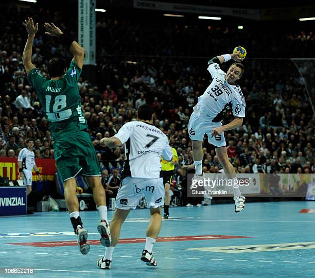 Filip Jicha of Kiel throws a goal during the Toyota Handball Bundesliga match between THW Kiel and HSG Wetzlar at the Sparkassen Arena on November 9...