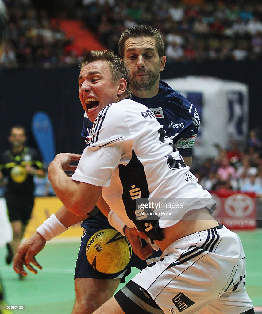 <a gi-track='captionPersonalityLinkClicked' href=/galleries/search?phrase=Filip+Jicha&family=editorial&specificpeople=620584 ng-click='$event.stopPropagation()'>Filip Jicha</a> (L) of THW Kiel is challenged by <a gi-track='captionPersonalityLinkClicked' href=/galleries/search?phrase=Guillaume+Gille&family=editorial&specificpeople=609796 ng-click='$event.stopPropagation()'>Guillaume Gille</a> of Hamburg during the Toyota Handball Supercup match between THW Kiel and HSV Handball at the Olympic hall on August 24, 2010 in Munich, Germany.
