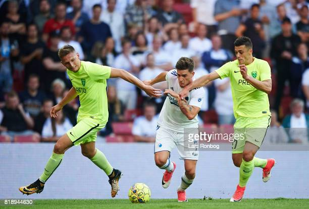 Filip Kasa of MSK Zilina Benjamin Verbic of FC Copenhagen and Robert Mazan of MSK Zilina compete for the ball during the UEFA Champions League...