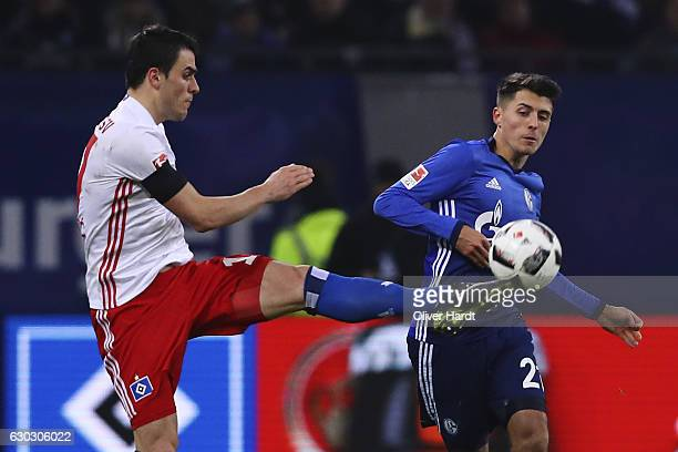 Filip Kostic of Hamburg and Alessandro Schoepf of Schalke compete for the ball during the Bundesliga match between Hamburger SV and FC Schalke 04 at...