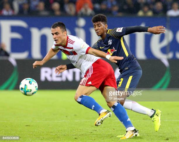 Filip Kostic of Hamburg and Bernardo of Leipzig battle for the ball during the Bundesliga match between Hamburger SV and RB Leipzig at...