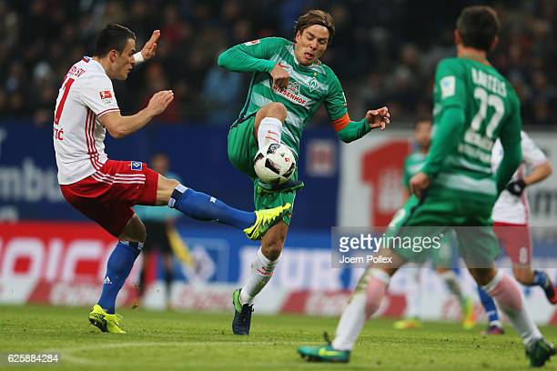 Filip Kostic of Hamburg and Clemens Fritz of Bremen compete for the ball during the Bundesliga match between Hamburger SV and Werder Bremen at...