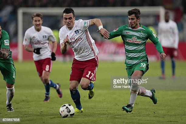 Filip Kostic of Hamburg and Fin Bartels of Bremen compete for the ball during the Bundesliga match between Hamburger SV and Werder Bremen at...