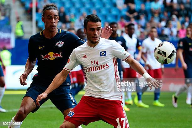 Filip Kostic of Hamburg and Yussuf Poulsen of Leipzig compete for the ball during the Bundesliga match between Hamburger SV and RB Leipzig at...