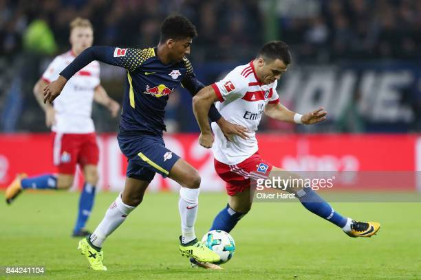 Filip Kostic of Hamburg is challenged by Bernardo of Leipzig during the Bundesliga match between Hamburger SV and RB Leipzig at Volksparkstadion on...