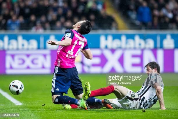 Filip Kostic of Hamburg is challenged by David Abraham of Frankfurt during the Bundesliga match between Eintracht Frankfurt and Hamburger SV at...