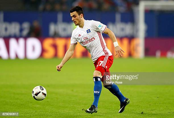 Filip Kostic of Hamburg runs with the ball during the Bundesliga match between Hamburger SV and FC Augsburg at Volksparkstadion on December 10 2016...