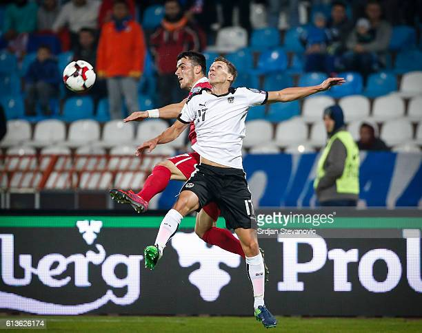 Filip Kostic of Serbia jump for the ball against Florian Klein of Austria during the FIFA 2018 World Cup Qualifier between Serbia and Austria at...