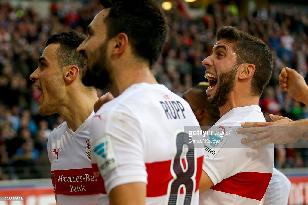 Filip Kostic (L) of Stuttgart celebrates the forth goal with Lukas Rupp and <a gi-track='captionPersonalityLinkClicked' href=/galleries/search?phrase=Emiliano+Insua&family=editorial&specificpeople=4125596 ng-click='$event.stopPropagation()'>Emiliano Insua</a> during the Bundesliga match between Eintracht Frankfurt and VfB Stuttgart at Commerzbank-Arena on February 6, 2016 in Frankfurt am Main, Germany.
