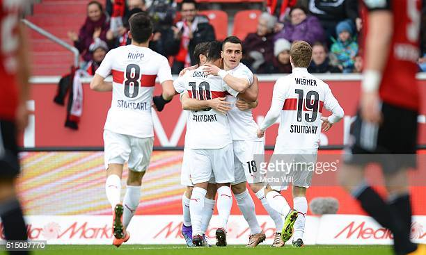 Filip Kostic of Stuttgart celebrates with teammates after scoring his team's second goal during the Bundesliga match between FC Ingolstadt and VfB...