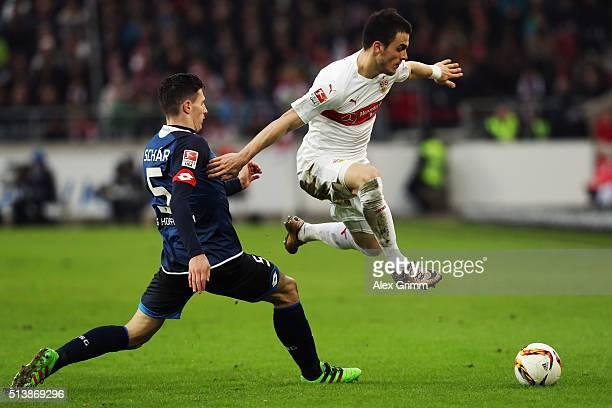 Filip Kostic of Stuttgart eludes Fabian Schaer of Hoffenheim during the Bundesliga match between VfB Stuttgart and 1899 Hoffenheim at MercedesBenz...