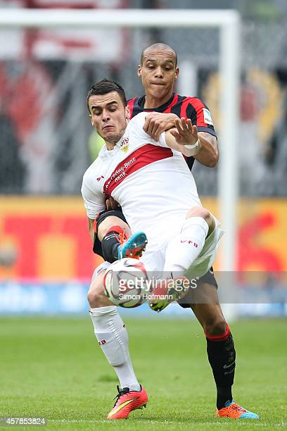 Filip Kostic of Stuttgart is challenged by Bamba Anderson of Frankfurt during the Bundesliga match between Eintracht Frankfurt and VfB Stuttgart at...