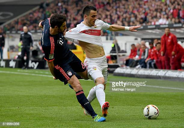 Filip Kostic of Stuttgart is challenged by Javi Martinez of Muenchen during the Bundesliga match between VfB Stuttgart and FC Bayern Muenchen at...