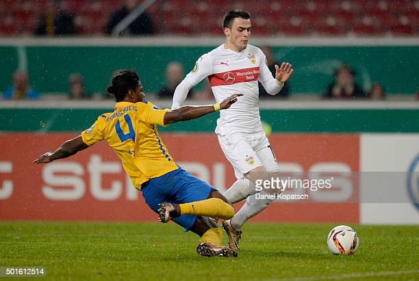 Filip Kostic of Stuttgart is challenged by Joseph Baffo of Braunschweig during the round of sixteen DFB Cup match between VfB Stuttgart and Eintracht...