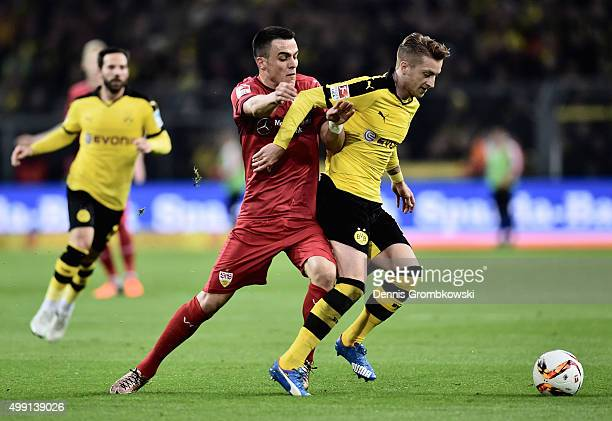 Filip Kostic of VfB Stuttgart challenges Marco Reus of Borussia Dortmund during the Bundesliga match between Borussia Dortmund and VfB Stuttgart at...