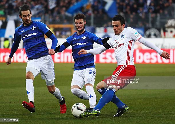 Filip Kostici of Hamburg is challenged by Marcel Heller of Darmstadt during the Bundesliga match between SV Darmstadt 98 and Hamburger SV at Stadion...