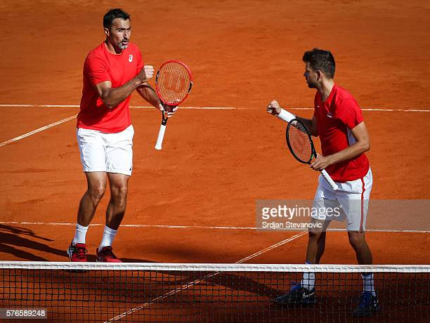 Filip Krajinovic and Nenad ZImonjic of Serbia celebrate a point in the doubles match against Jamie Murray and Dominic Inglot of Great Britain during...