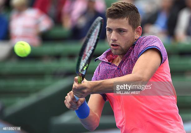 Filip Krajinovic of Serbia hits a backhand return during his match against Gilles Simon of France at the Kooyong Classic tennis event in Melbourne on...