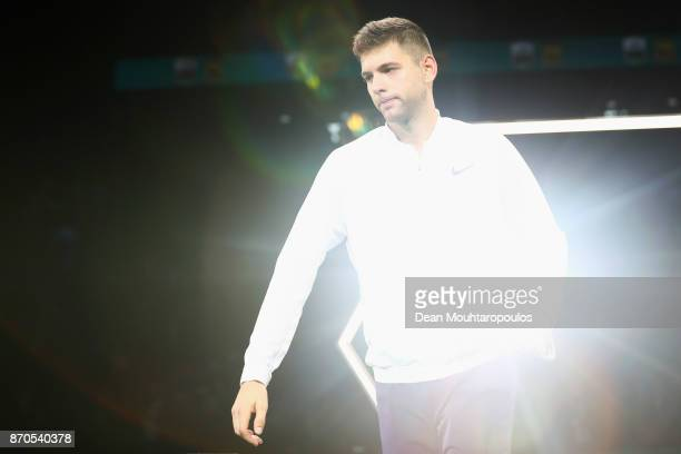 Filip Krajinovic of Serbia holds his runners up trophy as light reflects of it after defeat against Jack Sock of the USA during the Mens Final on day...