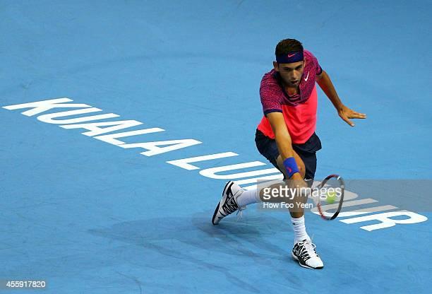 [Filip Krajinovic of Serbia in action against Taro Daniel of Japan at Putra Stadium on September 22 2014 in Kuala Lumpur Malaysia