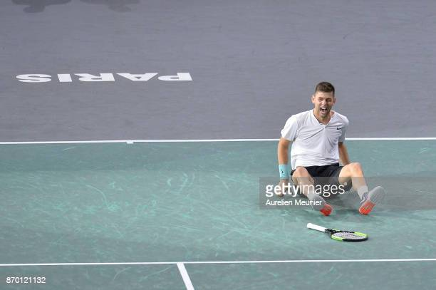 Filip Krajinovic of Serbia reacts after winning his men's singles semi final match against John Isner of the United States of America during day six...