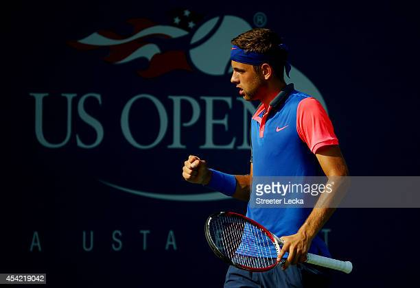 Filip Krajinovic of Serbia reacts against Tim Smyczek of the United States during their men's singles first round match on Day Two of the 2014 US...