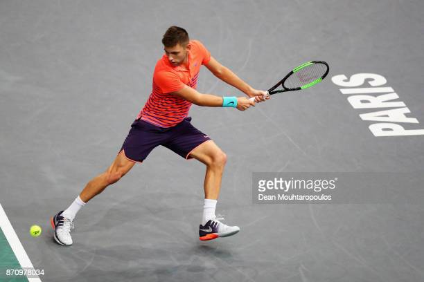 Filip Krajinovic of Serbia retruns a backhand against Jack Sock of the USA during the Mens Final on day 7 of the Rolex Paris Masters held at the...