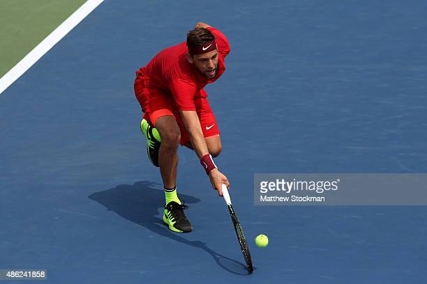 Filip Krajinovic of Serbia returns a shot against David Ferrer of Spain during their Men's Singles Second Round match on Day Three of the 2015 US...