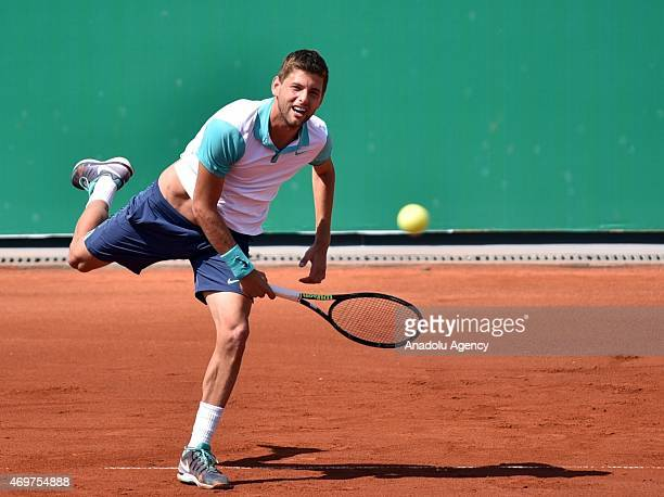 Filip Krajinovic of Serbia returns the ball to Roberto Carballes Baena of Spain during their men's singles tennis match at 4th Mersincup ATP...
