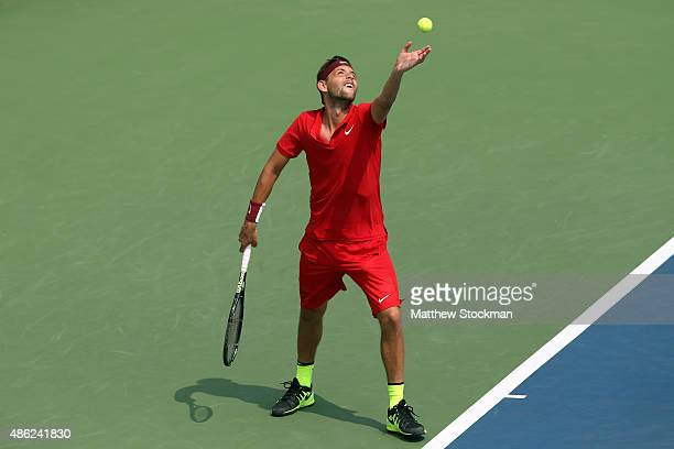 Filip Krajinovic of Serbia serves against David Ferrer of Spain during their Men's Singles Second Round match on Day Three of the 2015 US Open at the...