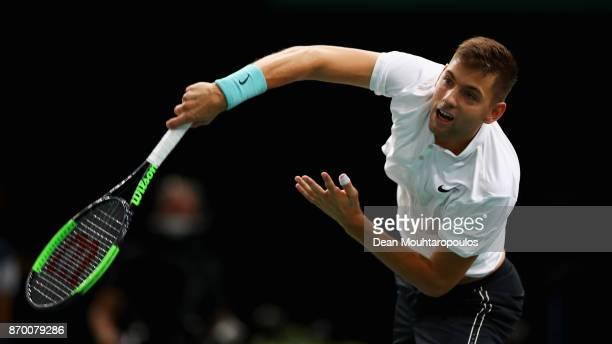 Filip Krajinovic of Serbia serves against John Isner of the USA during the semi finals on day 6 of the Rolex Paris Masters held at the AccorHotels...