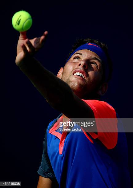 Filip Krajinovic of Serbia serves against Tim Smyczek of the United States during their men's singles first round match on Day Two of the 2014 US...