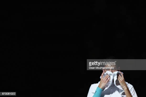 Filip Krajinovic of Serbia wipes his face with a towel between games against John Isner of the USA during the semi finals on day 6 of the Rolex Paris...