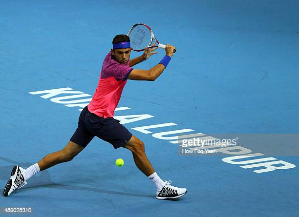 Filip Kranjinovic of Serbia in action against Julien Benneteau of France during the Malaysian Open at Putra Stadium on September 24 2014 in Kuala...