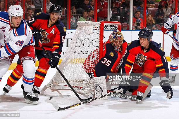 Filip Kuba assists Goaltender Jacob Markstrom of the Florida Panthers defend the net against Ryane Clowe of the New York Rangers at the BBT Center on...