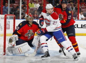 Filip Kuba assists goaltender Jose Theodore of the Florida Panthers defend the net as Alex Galchenyuk of the Montreal Canadiens takes up position for...