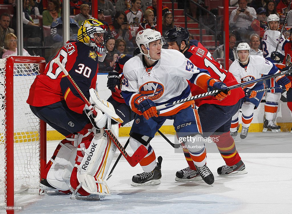 Filip Kuba #17 of the Florida Panthers attempts to clear Casey Cizikas #53 of the New York Islanders from in front of goaltender Scott Clemmensen #30 during second period action at the BB&T Center on March 16, 2013 in Sunrise, Florida.