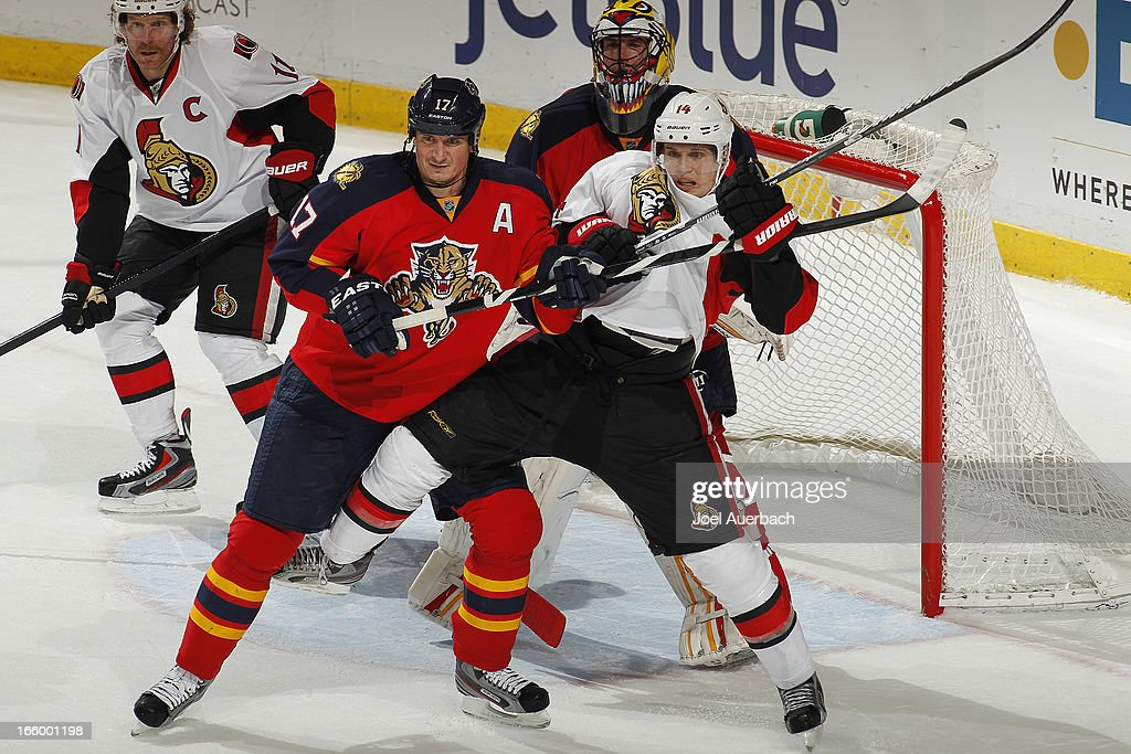 <a gi-track='captionPersonalityLinkClicked' href=/galleries/search?phrase=Filip+Kuba&family=editorial&specificpeople=209425 ng-click='$event.stopPropagation()'>Filip Kuba</a> #17 of the Florida Panthers battles in front of the net with <a gi-track='captionPersonalityLinkClicked' href=/galleries/search?phrase=Colin+Greening&family=editorial&specificpeople=7183741 ng-click='$event.stopPropagation()'>Colin Greening</a> #14 of the Ottawa Senators at the BB&T Center on April 7, 2013 in Sunrise, Florida. The Panthers defeated the Senators 2-1.