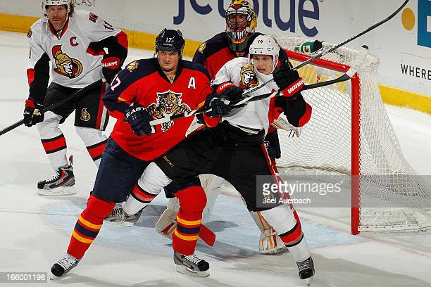 Filip Kuba of the Florida Panthers battles in front of the net with Colin Greening of the Ottawa Senators at the BBT Center on April 7 2013 in...