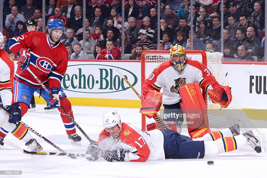 <a gi-track='captionPersonalityLinkClicked' href=/galleries/search?phrase=Filip+Kuba&family=editorial&specificpeople=209425 ng-click='$event.stopPropagation()'>Filip Kuba</a> #17 of the Florida Panthers blocks a pass intended of <a gi-track='captionPersonalityLinkClicked' href=/galleries/search?phrase=Erik+Cole&family=editorial&specificpeople=204754 ng-click='$event.stopPropagation()'>Erik Cole</a> #72 of the Montreal Canadiens during the NHL game at the Bell Centre on January 22, 2013 in Montreal, Quebec, Canada. The Canadiens defeated the Panthers 4-1.