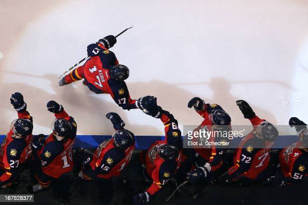 Filip Kuba of the Florida Panthers celebrates his goal with teammates against the New York Rangers at the BBT Center on April 23 2013 in Sunrise...