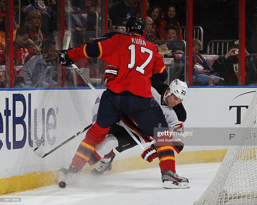 Filip Kuba #17 of the Florida Panthers checks David Clarkson #23 of the New Jersey Devils off the puck at the BB&T Center on March 30, 2013 in Sunrise, Florida.