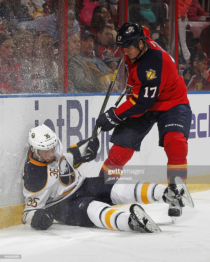 Filip Kuba #17 of the Florida Panthers checks Patrick Kaleta #36 of the Buffalo Sabres to the ice at the BB&T Center on March 28, 2013 in Sunrise, Florida.